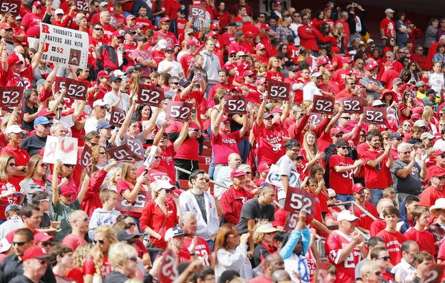 Sep 14, 2013; Piscataway, NJ, USA;  Rutgers Scarlet Knights fans hold up #52 cards in honor of Eric LeGrand jersey retirement ceremony during halftime of game against the Eastern Michigan Eagles at High Points Solutions Stadium. Mandatory Credit: Jim O'Connor-USA TODAY Sports