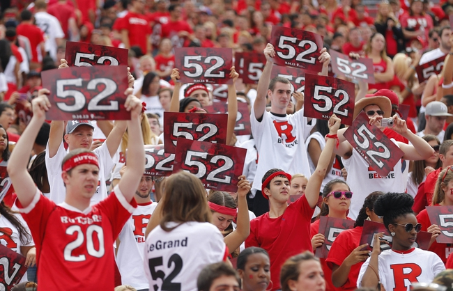 Sep 14, 2013; Piscataway, NJ, USA;  Rutgers Scarlet Knights student body holds up #52 cards in honor of Eric LeGrand jersey retirement ceremony during halftime of game against the Eastern Michigan Eagles at High Points Solutions Stadium. Mandatory Credit: Jim O'Connor-USA TODAY Sports