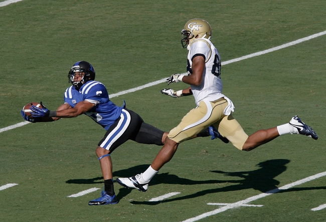 Sep 14, 2013; Durham, NC, USA; Duke Blue Devils cornerback Ross Cockrell (6) intercepts the ball in front of Georgia Tech Yellow Jackets wide receiver Darren Waller (88) at Wallace Wade Stadium. Mandatory Credit: Mark Dolejs-USA TODAY Sports