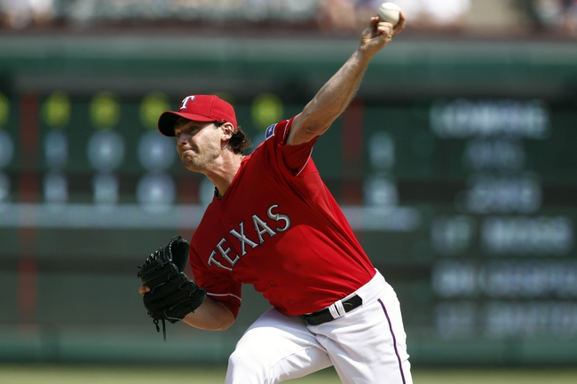 Sep 14, 2013; Arlington, TX, USA; Texas Rangers relief pitcher Neal Cotts (56) throws to the Oakland Athletics during the ninth inning of a baseball game at Rangers Ballpark in Arlington. The Athletics won 1-0. Mandatory Credit: Jim Cowsert-USA TODAY Sports