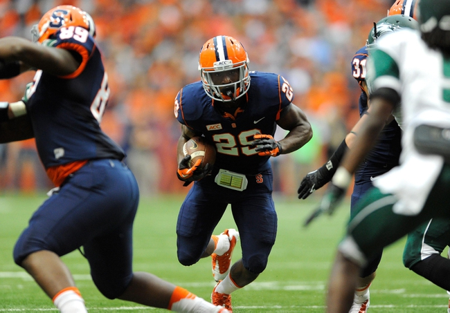 Sep 14, 2013; Syracuse, NY, USA; Syracuse Orange running back Devante McFarlane (29) runs with the ball during the second quarter against the Wagner Seahawks at the Carrier Dome.  Mandatory Credit: Rich Barnes-USA TODAY Sports