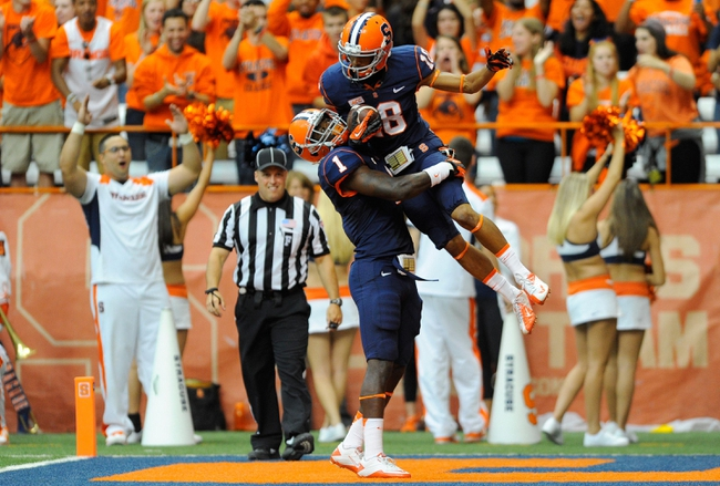 Sep 14, 2013; Syracuse, NY, USA; Syracuse Orange wide receiver Christopher Clark (18) celebrates a touchdown with running back Ashton Broyld (1) during the second quarter against the Wagner Seahawks at the Carrier Dome.  Mandatory Credit: Rich Barnes-USA TODAY Sports