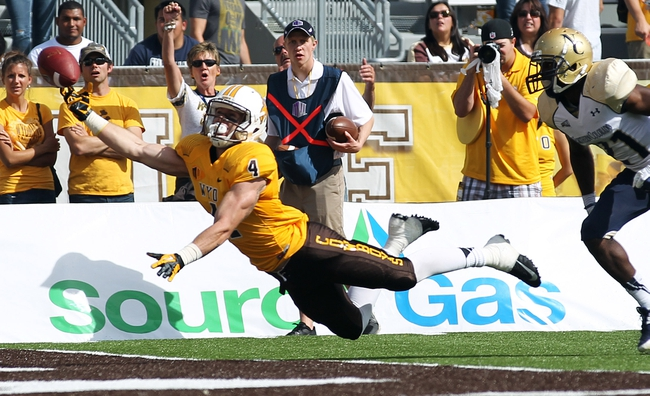 Sep 14, 2013; Laramie, WY, USA; Wyoming Cowboys wide receiver Tanner Gentry (4) is unable to pull in a pass against Northern Colorado Bears cornerback Hakeem Deggs (21) during the second half at War Memorial Stadium. Mandatory Credit: Troy Babbitt-USA TODAY Sports