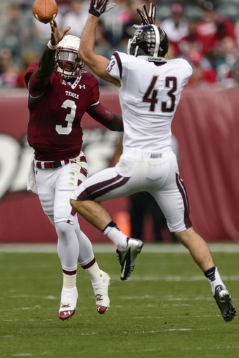 Sep 14, 2013; Philadelphia, PA, USA; Fordham Rams linebacker Stephen Hodge (43) knocks down the pass of Temple Owls quarterback Clinton Granger (3) during the first quarter at Lincoln Financial Field. Fordham defeated Temple 30-29. Mandatory Credit: Howard Smith-USA TODAY Sports