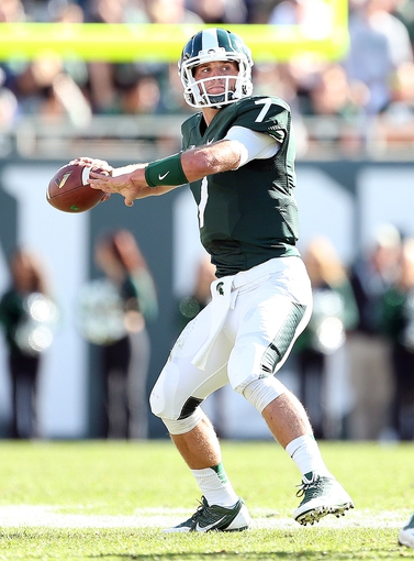 Sep 14, 2013; East Lansing, MI, USA; Michigan State Spartans quarterback Tyler O'Connor (7) attempts to throw the ball against the Youngstown State Penguins during the second half in a game at Spartan Stadium. MSU won 55-17.Mandatory Credit: Mike Carter-USA TODAY Sports