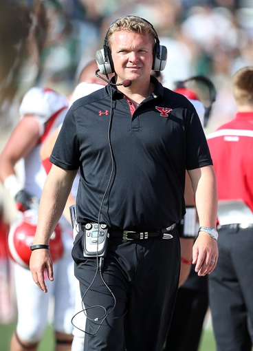 Sep 14, 2013; East Lansing, MI, USA; Youngstown State Penguins head coach Eric Wolford walks the sidelines during the second half of a game between the Michigan State Spartans and the Youngstown State Penguins at Spartan Stadium. MSU won 55-17.Mandatory Credit: Mike Carter-USA TODAY Sports