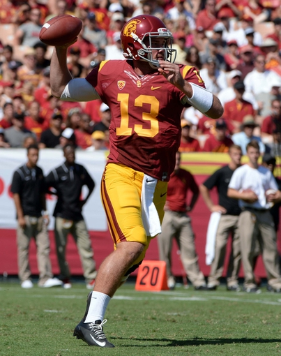 Sep 14, 2013; Los Angeles, CA, USA; USC Trojans quarterback Max Wittek (13) throws a pass during fourth quarter action against the Boston College Eagles at Los Angeles Memorial Coliseum. USC went on to a 35-7. Mandatory Credit: Robert Hanashiro-USA TODAY Sports