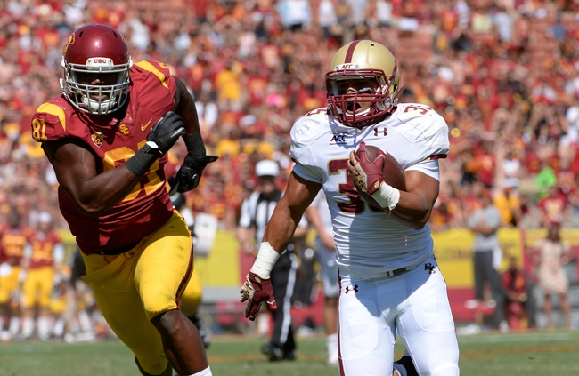 Sep 14, 2013; Los Angeles, CA, USA; Boston College Eagles running back Tyler Rouse (35) runs past USC linebacker Kevin Greene (81) on his way to a scoring a fourth quarter touchdown at Los Angeles Memorial Coliseum. 
