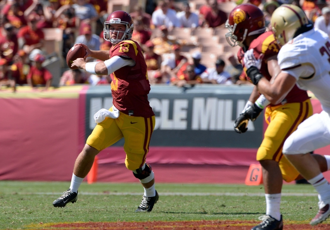 Sep 14, 2013; Los Angeles, CA, USA; USC Trojans quarterback Max Wittek (13) rolls out as he throws a pass against Boston College during fourth quarter action at Los Angeles Memorial Coliseum. USC went on to a 35-7 win. Mandatory Credit: Robert Hanashiro-USA TODAY Sports