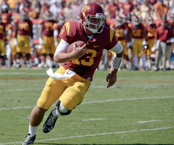 Sep 14, 2013; Los Angeles, CA, USA;  USC Trojans quarterback Max Wittek (13) sprints to the endzone to score a touchdown against Boston College  at Los Angeles Memorial Coliseum. The Trojans won 35-7. Mandatory Credit: Robert Hanashiro-USA TODAY Sports