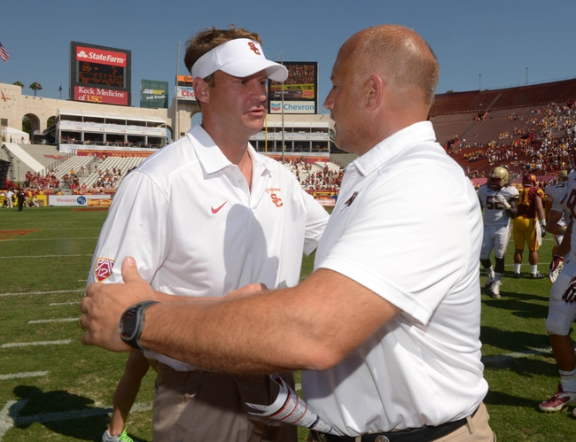 Sep 14, 2013; Los Angeles, CA, USA; Southern California Trojans coach Lane Kiffin (left) and Boston College Eagles coach Steve Addazio shake hands at the end of the game at Los Angeles Memorial Coliseum. USC defeated Boston College 35-7. Mandatory Credit: Kirby Lee-USA TODAY Sports