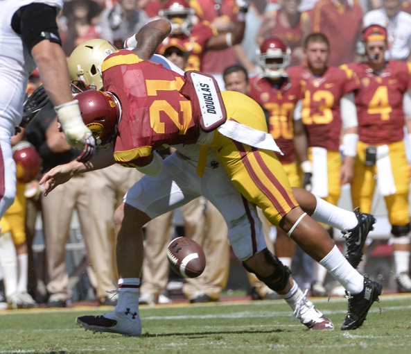 Sep 14, 2013; Los Angeles, CA, USA; USC Trojans safety Su'a Cravens (21) knocks the ball out of the hands of Boston College Eagles quarterback Chase Rettig (11) during second half action at Los Angeles Memorial Coliseum. Boston College retained possession of the ball. Mandatory Credit: Robert Hanashiro-USA TODAY Sports