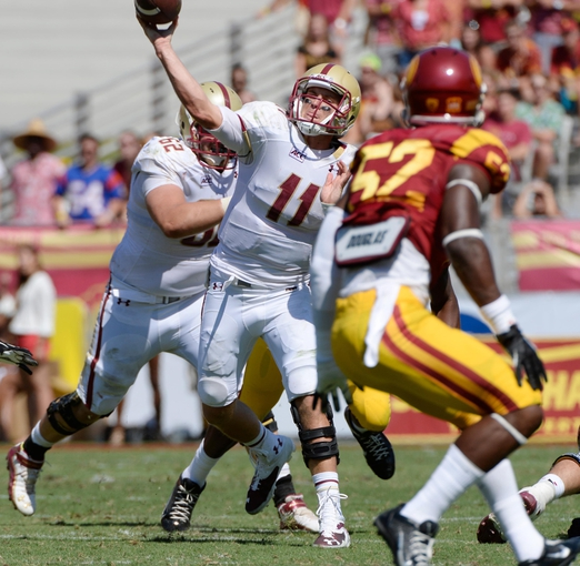 Sep 14, 2013; Los Angeles, CA, USA; Boston College Eagles quarterback Chase Rettig (11) throws a second half pass against the USC Trojans at Los Angeles Memorial Coliseum. Boston College lost 35-7 to the Trojans. Mandatory Credit: Robert Hanashiro-USA TODAY Sports