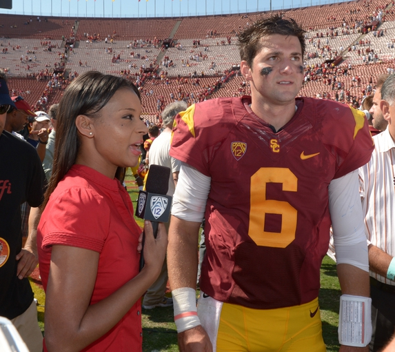 Sep 14, 2013; Los Angeles, CA, USA; Pac-12 Network sideline reporter Drea Avent (left) interviews Southern California Trojans quarterback Cody Kessler (6) after the game against the Boston College Eagles at Los Angeles Memorial Coliseum. USC defeated Boston College 35-7. Mandatory Credit: Kirby Lee-USA TODAY Sports
