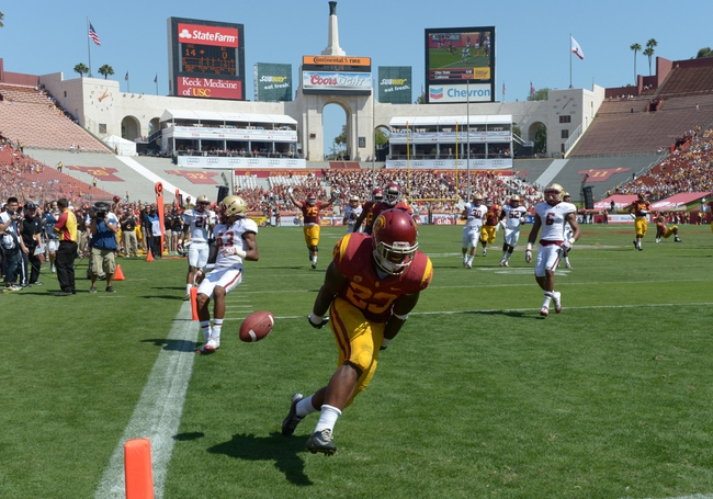 Sep 14, 2013; Los Angeles, CA, USA; Southern California Trojans tailback Tre Madden (23) scores on a 30-yard touchdown run in the third quarter against the Boston College Eagles at Los Angeles Memorial Coliseum. Mandatory Credit: Kirby Lee-USA TODAY Sports