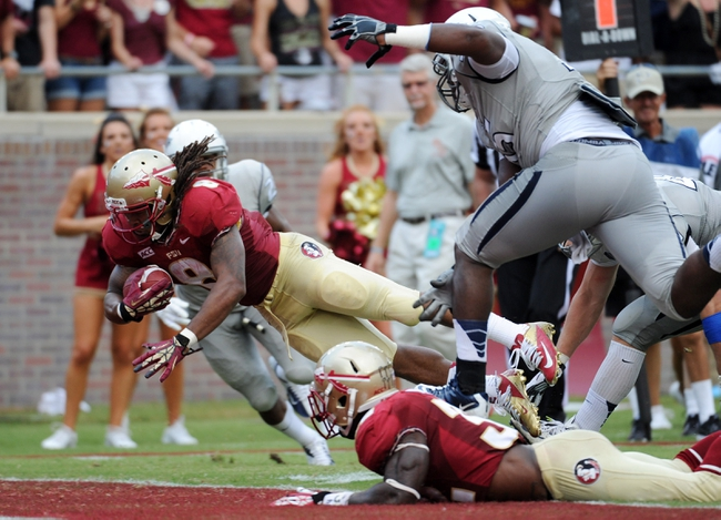 Sep 14, 2013; Tallahassee, FL, USA; Florida State Seminoles running back Devonta Freeman (8) runs the ball for a touchdown during the second half of the game against the Nevada Wolf Pack at Doak Campbell Stadium. Mandatory Credit: Melina Vastola-USA TODAY Sports