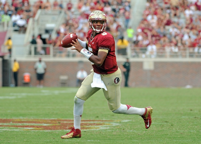 Sep 14, 2013; Tallahassee, FL, USA; Florida State Seminoles quarterback Jameis Winston (5) runs the ball for a touchdown during the second half of the game against the Nevada Wolf Pack at Doak Campbell Stadium. Mandatory Credit: Melina Vastola-USA TODAY Sports