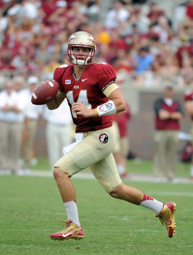 Sep 14, 2013; Tallahassee, FL, USA; Florida State Seminoles quarterback Jacob Coker (14) runs the ball during the second half of the game against the Nevada Wolf Pack at Doak Campbell Stadium. Mandatory Credit: Melina Vastola-USA TODAY Sports