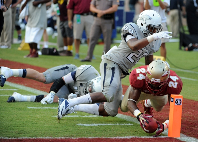 Sep 14, 2013; Tallahassee, FL, USA; Florida State Seminoles running back Ryan Green (24) dives for the endzone but was ruled out of bounds past Nevada Wolf Pack defensive back Elijah Mitchell (28) during the second half of the game at Doak Campbell Stadium. Mandatory Credit: Melina Vastola-USA TODAY Sports