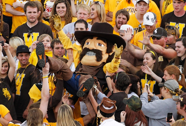 Sep 14, 2013; Laramie, WY, USA; Wyoming Cowboys mascot Pistol Pete is lifted through the crowd in a game against the Northern Colorado Bears during the fourth quarter at War Memorial Stadium. Mandatory Credit: Troy Babbitt-USA TODAY Sports