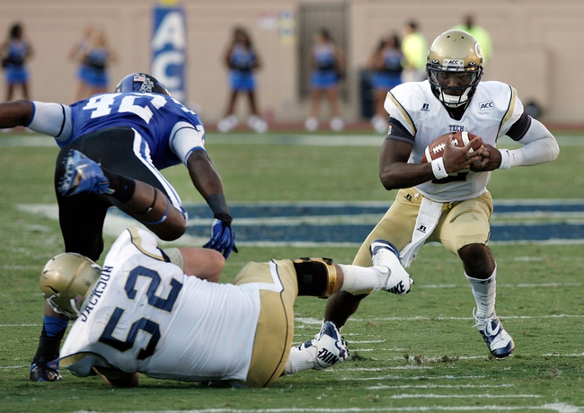Sep 14, 2013; Durham, NC, USA; Georgia Tech Yellow Jackets quarterback Vad Lee (2) looks for running room on the keeper against the Duke Blue Devils at Wallace Wade Stadium. Mandatory Credit: Mark Dolejs-USA TODAY Sports