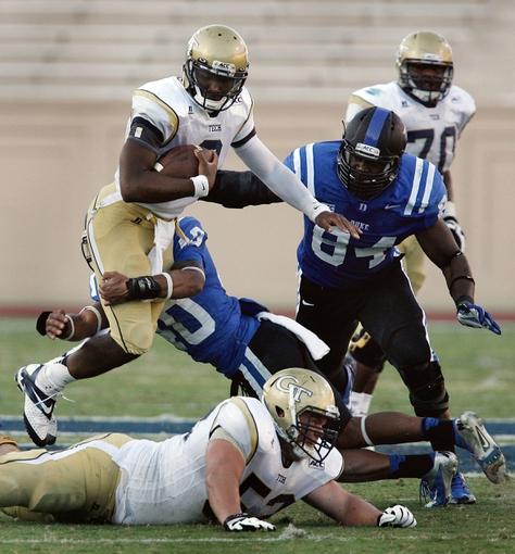 Sep 14, 2013; Durham, NC, USA; Duke Blue Devils safety Dwayne Norman (40) tackles Georgia Tech Yellow Jackets quarterback Vad Lee (2) as he keeps the ball for a run at Wallace Wade Stadium. Mandatory Credit: Mark Dolejs-USA TODAY Sports