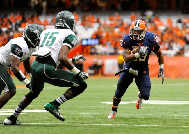 Sep 14, 2013; Syracuse, NY, USA; Syracuse Orange running back Prince-Tyson Gulley (23) runs with the ball around Wagner Seahawks defensive back Keith Foster (15) during the third quarter at the Carrier Dome.  Syracuse defeated Wagner 54-0.  Mandatory Credit: Rich Barnes-USA TODAY Sports