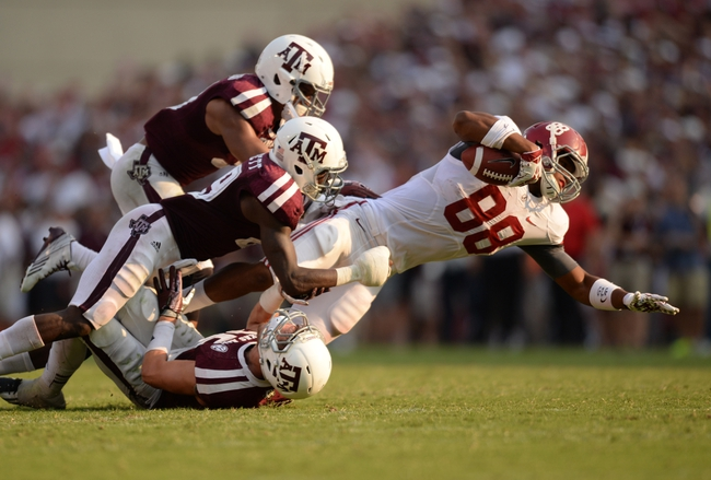 Sep 14, 2013; College Station, TX, USA; Alabama Crimson Tide tight end O.J. Howard (88) runs with a catch as he is tackled by Texas A&M Aggies defensive back Clay Honeycutt (25) and defensive back Deshazor Everett (29) during the second half at Kyle Field. Mandatory Credit: Thomas Campbell-USA TODAY Sports