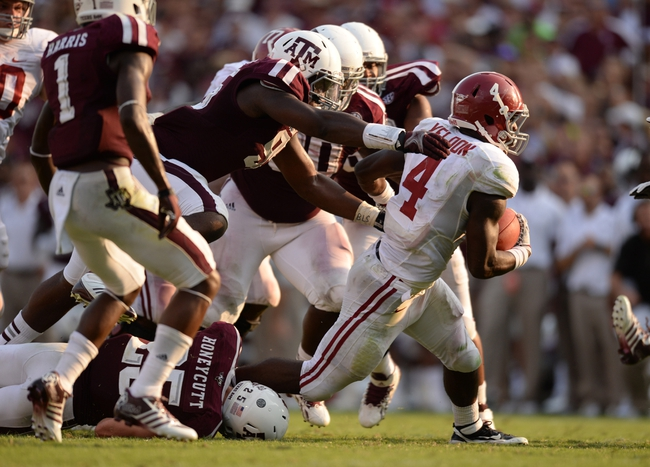 Sep 14, 2013; College Station, TX, USA; Alabama Crimson Tide running back T.J. Yeldon (4) rushes against the Texas A&M Aggies during the second half at Kyle Field. Mandatory Credit: Thomas Campbell-USA TODAY Sports