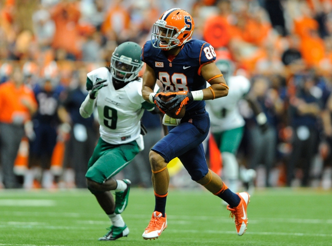 Sep 14, 2013; Syracuse, NY, USA; Syracuse Orange wide receiver Jarrod West (88) runs with the ball on his way to the end zone in front of Wagner Seahawks defensive back Deangelo James (9) during the third quarter at the Carrier Dome.  Syracuse defeated Wagner 54-0.  Mandatory Credit: Rich Barnes-USA TODAY Sports
