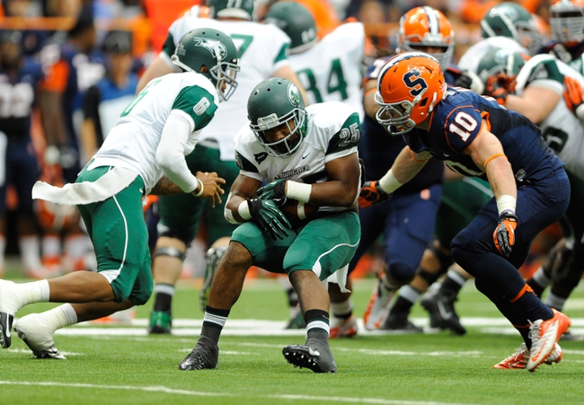 Sep 14, 2013; Syracuse, NY, USA; Syracuse Orange linebacker Josh Kirkland (10) prepares to tackle Wagner Seahawks running back Dominique Williams (25) during the third quarter at the Carrier Dome.  Syracuse defeated Wagner 54-0.  Mandatory Credit: Rich Barnes-USA TODAY Sports