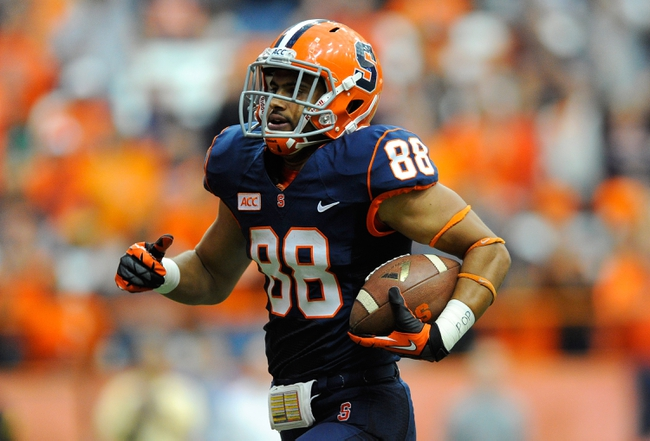 Sep 14, 2013; Syracuse, NY, USA; Syracuse Orange wide receiver Jarrod West (88) runs with the ball on his way to the end zone against the Wagner Seahawks during the third quarter at the Carrier Dome.  Syracuse defeated Wagner 54-0.  Mandatory Credit: Rich Barnes-USA TODAY Sports