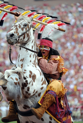 Sep 14, 2013; Tallahassee, FL, USA; Florida State Seminoles mascot Chief Osceola rears the horse Renegade during the second half of the game against the Nevada Wolf Pack at Doak Campbell Stadium. Mandatory Credit: Melina Vastola-USA TODAY Sports