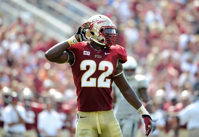 Sep 14, 2013; Tallahassee, FL, USA; Florida State Seminoles linebacker Telvin Smith (22) during the first half of the game at Doak Campbell Stadium. Mandatory Credit: Melina Vastola-USA TODAY Sports