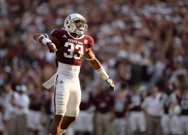Sep 14, 2013; College Station, TX, USA; Texas A&M Aggies linebacker Shaan Washington (33) celebrates a tackle against the Alabama Crimson Tide during the second half at Kyle Field. Mandatory Credit: Thomas Campbell-USA TODAY Sports