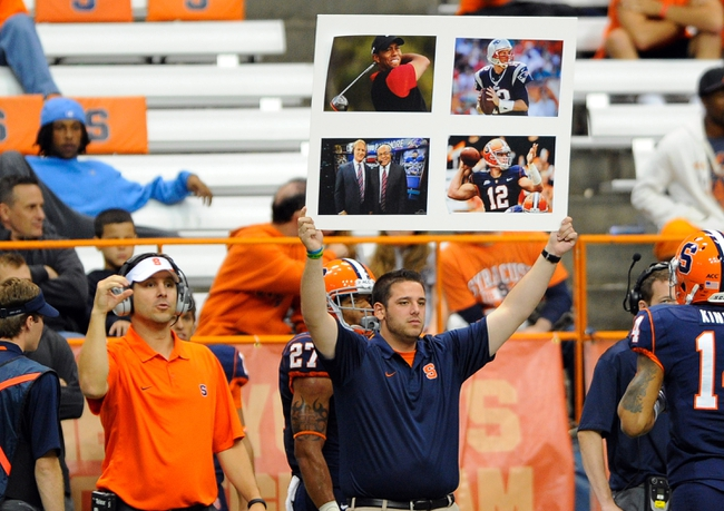Sep 14, 2013; Syracuse, NY, USA; A Syracuse Orange staff member holds up an offensive play sign during the fourth quarter against the Wagner Seahawks at the Carrier Dome.  Syracuse defeated Wagner 54-0.  Mandatory Credit: Rich Barnes-USA TODAY Sports