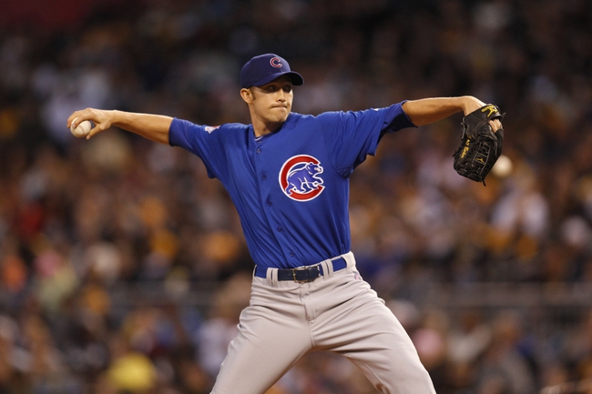 Sep 14, 2013; Pittsburgh, PA, USA; Chicago Cubs starting pitcher Scott Baker (32) delivers a pitch against the Pittsburgh Pirates during the second inning at PNC Park. Mandatory Credit: Charles LeClaire-USA TODAY Sports