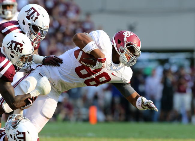 Sep 14, 2013; College Station, TX, USA; Alabama Crimson Tide tight end O.J. Howard (88) runs after a catch as he is tackled by Texas A&M Aggies defensive back Clay Honeycutt (25) and defensive back Deshazor Everett (29) during the second half at Kyle Field. . Alabama Crimson Tide beat the Texas A&M Aggies 49-42. Mandatory Credit: Matthew Emmons-USA TODAY Sports