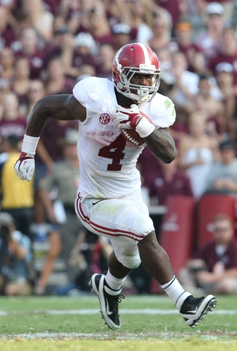 Sep 14, 2013; College Station, TX, USA; Alabama Crimson Tide running back T.J. Yeldon (4) runs with the ball in the fourth quarter against the Texas A&M Aggies at Kyle Field. Mandatory Credit: Matthew Emmons-USA TODAY Sports