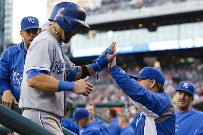 Sep 14, 2013; Detroit, MI, USA; Kansas City Royals left fielder Alex Gordon (4) receive congratulation from manager Ned Yost (3) after scoring in the first inning against the Detroit Tigers at Comerica Park. Mandatory Credit: Rick Osentoski-USA TODAY Sports