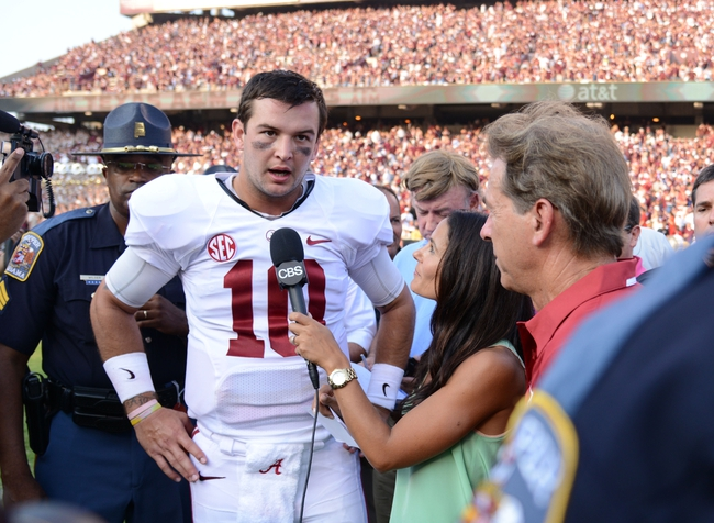 Sep 14, 2013; College Station, TX, USA; Alabama Crimson Tide quarterback AJ McCarron (10) is interviewed against the Texas A&M Aggies after the game at Kyle Field. Alabama Crimson Tide beat the Texas A&M Aggies 49-42. Mandatory Credit: Thomas Campbell-USA TODAY Sports