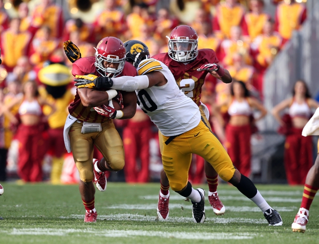 September 14, 2013; Ames, IA, USA;  Iowa State Cyclones running back  James White (8) gets hit by Iowa Hawkeyes linebacker Christian Kirksey (20) in the first quarter at Jack Trice Stadium. Mandatory Credit: Reese Strickland-US PRESSWIRE