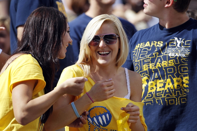 Sep 14, 2013; Laramie, WY, USA; Northern Colorado Bears fans cheer against the Wyoming Cowboys during the first quarter at War Memorial Stadium. Mandatory Credit: Troy Babbitt-USA TODAY Sports