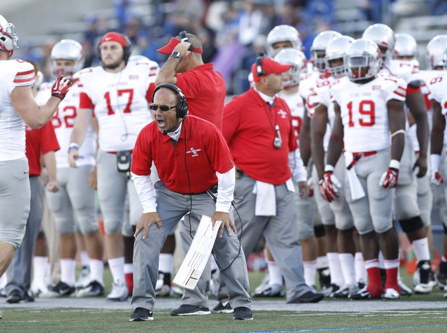 Sep 14, 2013; Buffalo, NY, USA; Stony Brook Seawolves head coach Chuck Priore yells to the referee during the second half against the Buffalo Bulls at University of Buffalo Stadium. Buffalo beats Stony Brook 26-23 in OT. Mandatory Credit: Kevin Hoffman-USA TODAY Sports
