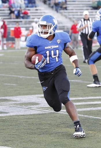 Sep 14, 2013; Buffalo, NY, USA; Buffalo Bulls running back Anthone Taylor (14) runs with the ball during the second half against the Stony Brook Seawolves at University of Buffalo Stadium. Buffalo beats Stony Brook 26-23 in OT. Mandatory Credit: Kevin Hoffman-USA TODAY Sports
