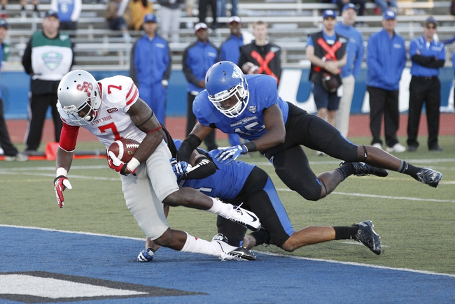 Sep 14, 2013; Buffalo, NY, USA; Stony Brook Seawolves defensive back Reuben Johnson (7) scores a touchdown against the Buffalo Bulls during the second half at University of Buffalo Stadium. Buffalo beats Stony Brook 26-23 in OT. Mandatory Credit: Kevin Hoffman-USA TODAY Sports
