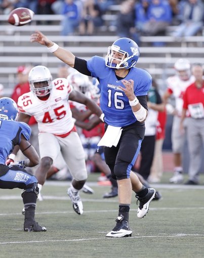Sep 14, 2013; Buffalo, NY, USA; Buffalo Bulls quarterback Joe Licata (16) passes against the Stony Brook Seawolves during the second half at University of Buffalo Stadium. Buffalo beats Stony Brook 26-23 in OT. Mandatory Credit: Kevin Hoffman-USA TODAY Sports