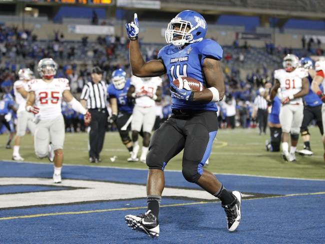 Sep 14, 2013; Buffalo, NY, USA; Buffalo Bulls running back Anthone Taylor (14) runs for the winning touchdown in OT against the Stony Brook Seawolves at University of Buffalo Stadium. Buffalo beats Stony Brook 26-23 in OT. Mandatory Credit: Kevin Hoffman-USA TODAY Sports