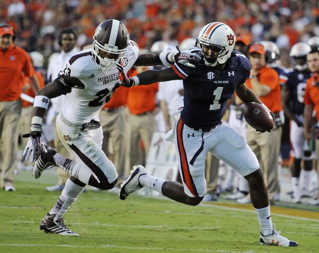 Sep 14, 2013; Auburn, AL, USA; Auburn Tigers wide receiver Trovon Reed (1) tries to outrun Mississippi State Bulldogs defensive back Taveze Calhoun (23) at Jordan Hare Stadium. Mandatory Credit: Shanna Lockwood-USA TODAY Sports