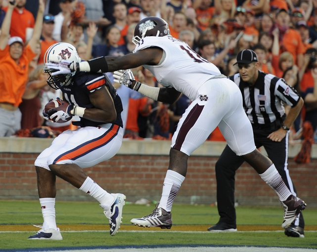 Sep 14, 2013; Auburn, AL, USA;  Auburn Tigers cornerback Chris Davis (11) catches the two-point conversion in spite of the defense of Mississippi State Bulldogs linebacker Deontae Skinner (11) during the first half at Jordan Hare Stadium. Mandatory Credit: Shanna Lockwood-USA TODAY Sports